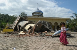 At least 25 people died and hundreds were injured after a strong earthquake struck off Aceh province on Indonesia's Sumatra island on December 7, local officials said. / AFP PHOTO / CHAIDEER MAHYUDDIN