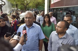 Ahmed Thasmeen Ali (L), the Home Minister of Maldives United Opposition (MUO)'s Shadow Cabinet, speaks to reporters.