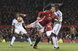 Manchester United's Swedish striker Zlatan Ibrahimovic (C) tries to control the ball during the English Premier League football match between Manchester United and Sunderland at Old Trafford in Manchester, north west England, on December 26, 2016. / AFP PHOTO / Oli SCARFF / RESTRICTED TO EDITORIAL USE. No use with unauthorized audio, video, data, fixture lists, club/league logos or 'live' services. Online in-match use limited to 75 images, no video emulation. No use in betting, games or single club/league/player publications. /
