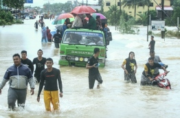 Emergency services in Malaysia deployed boats and trucks on January 3, as thousands of villagers were stranded after four days of heavy rain caused flooding in east coast states, officials said. / AFP PHOTO / STR / Malaysia OUT