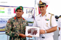 MNDF Marine Corps' Brigadier General Ali Zuhair (L) accepts India's gift of military spare parts from Indian Defence Advisor to the Maldives, Captain Prashanth Handu. PHOTO/MNDF