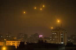 """Israel struck a number of Hamas positions in Gaza after a """"projectile"""" fired from the Palestinian enclave crashed in a border area, the Israeli army said. / AFP PHOTO / MAHMUD HAMS"""