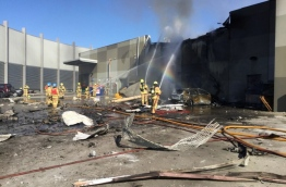 """A light aircraft exploded on February 21 in a """"massive fireball"""" with police saying none of the five people aboard survived as it smashed into a shopping centre near the Australian city of Melbourne. / AFP PHOTO / METROPOLITAN FIRE BRIGADE (MFB) MEDIA / Handout / RESTRICTED TO EDITORIAL USE - MANDATORY CREDIT """"AFP PHOTO / METROPOLITAN FIRE BRIGADE (MFB) MEDIA"""" - NO MARKETING NO ADVERTISING CAMPAIGNS - DISTRIBUTED AS A SERVICE TO CLIENTS"""