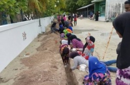 Women of B.Goidhoo laying cables for the island-wide solar panel project. PHOTO/EYDHAFUSHI OFFICE