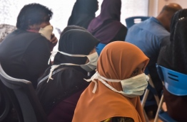 People donning masks wait in the flu clinic established in IGMH to test for swine flu. PHOTO: HUSSAIN WAHEED/MIHAARU