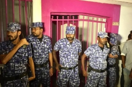 Police officers outside the former PPM office after taking down PPM's flag and logo from the building. PHOTO: NISHAN ALI/MIHAARU
