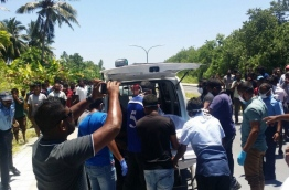The remains of a missing expat found dead in L. Fonadhoo being loaded onto a vehicle to be taken to hospital. PHOTO/RAAJJE.MV