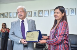 Pakistan Ambassador Syed Khawar Ali Shah (L) donating 15 laptops to Maldivian schools. received by Education Minister Aishath Shiham. PHOTO: Hussain Waheed/Mihaaru