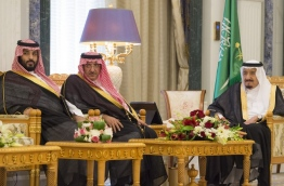 "A handout picture provided by the Saudi Royal Palace on April 24, 2017 shows Saudi Arabia's King Salman bin Abdulaziz al-Saud (R), Crown Prince Mohammed bin Nayef (C), and Deputy Crown Prince Mohammed bin Salman (L) attending a swearing in ceremony for new cabinet ministers and ambassadors in the capital Riyadh. / AFP PHOTO / Saudi Royal Palace / BANDAR AL-JALOUD / RESTRICTED TO EDITORIAL USE - MANDATORY CREDIT ""AFP PHOTO / SAUDI ROYAL PALACE / BANDAR AL-JALOUD"" - NO MARKETING - NO ADVERTISING CAMPAIGNS - DISTRIBUTED AS A SERVICE TO CLIENTS"