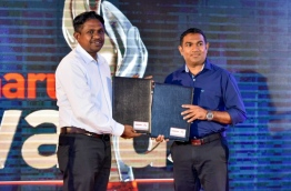 Ooredoo Head of Sales Hussain Niyaz pictured at the signing ceremony of Mihaaru Awards with CEO Riffath Mohamed PHOTO:Nishan Ali/MIHAARU
