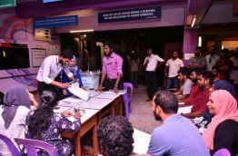 Vote counting proceeds at a polling station of the Local Council Elections 2017. PHOTO: HUSSAIN WAHEED/MIHAARU