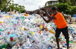 Communities are becoming more aware of good waste practices. Here, Abdul Latheef from Laamu Maamendhoo Island organizes the segregated plastics at their waste centre established with UNDP support. PHOTO/UNDP MALDIVES
