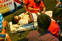 A person injured in a marine accident between a speedboat and a fishing boat being taken to the hospital in capital Male. PHOTO:Hussain Waheed/Mihaaru