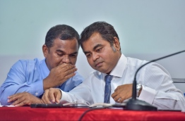 Energy minister Thoriq (R) and state minister Matheen speak to each other during press conference. PHOTO: NISHAN ALI/MIHAARU