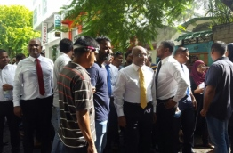Opposition lawmakers outside the parliament after MNDF and Police forcibly removed them from the building. PHOTO/MIHAARU