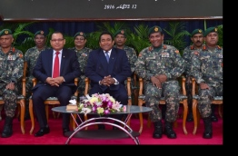 Defence Minister Adam Shareef (L) and President Abdulla Yameen at an MNDF event.
