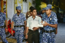 Police officers arrest Thulusdhoo MP Mohamed Waheed Ibrahim. FILE PHOTO/MIHAARU