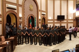 Security officers surround Speaker Maseeh inside the parliament chambers.