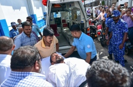 Maamigili MP Qasim Ibrahim carried out from the Criminal Court on a stretcher to the ambulance after he fainted during his hearing. PHOTO: HUSSAIN WAHEED/MIHAARU