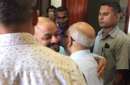 Dhiggaru MP Faris Maumoon with his father, former president Maumoon Abdul Gayoom, after the MP's trial at the Criminal Court. PHOTO / MIHAARU