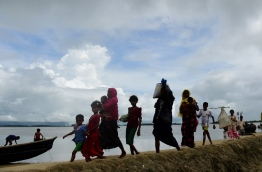 """Some 370,000 Rohingya have fled Myanmar and entered Bangladesh since an upsurge in violence late last month, the United Nations said September 12. """"An estimated 370,000 Rohingya have entered Bangladesh after fleeing violence in Myanmar's Rakhine state since August 25,"""" Joseph Tripura, a spokesman for the UN refugee agency, told AFP. / AFP PHOTO / MUNIR UZ ZAMAN"""