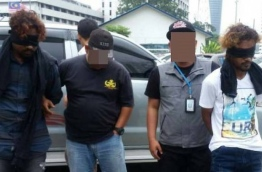 Malaysian police take away some people arrested from a terror ring during a major bust in August 2017.