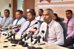 Housing Minister Mohamed Muizzu (R) speaks at housing ministry press conference regarding the distribution of flats from the government's first social housing project. PHOTO: HUSSAIN WAHEED/MIHAARU