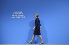 Britain's Prime Minister Theresa May takes the stage to deliver her speech on the final day of the Conservative Party annual conference at the Manchester Central Convention Centre in Manchester, northwest England, on October 4, 2017. / AFP PHOTO / Oli SCARFF