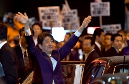 Prime Minister Shinzo Abe on October 21 vowed to step up pressure on North Korea to protect the Japanese people as he wrapped up an election campaign dominated by threats from Pyongyang. / AFP PHOTO / Toshifumi KITAMURA
