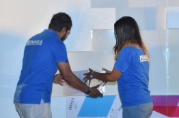 """Two staff of Fenaka lays the foundation of one of the towers to be developed under the mega """"Hiyaa"""" project in Hulhumale's second phase of development. PHOTO/PRESIDENT'S OFFICE"""