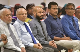 Faaris Maumoon (3rd L) pictured with his father Gayoom (2nd L) and the then home minister Umar Naseer (4th L) during a ceremony. MIHAARU FILE PHOTO/MOHAMED SHARUHAAN