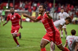 "Ali ""Dhagandey"" Ashfaq celebrates after scoring against Laos: he is ranked the top scorer in goals-to-appearance ratio by the end of 2017."