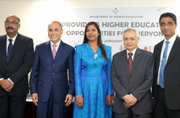 Education minister Dr Aishath Shiham (C) poses for picture with senior officials of the four universities offering higher education scholarships for Maldivian students. PHOTO/EDUCATION MINISTRY
