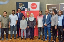 First Lady Fathimath Ibrahim (C), tourism minister Moosa Zameer (R-4), FAM president Bassam Adeel Jaleel (L-2), Christian Karembeu (L-3) and other officials of the tourism ministry and FAM after unveiling the FIFA World Cup Trophy in VIA's VIP Lounge. PHOTO: NISHAN ALI/MIHAARU