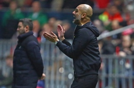 Manchester City's Spanish manager Pep Guardiola (R) gestures on the touchline during the English League Cup semi-final, second leg football match between Bristol City and Manchester City at Ashton Gate Stadium in Bristol, south-west England on January 23, 2018. / AFP PHOTO / Geoff CADDICK / RESTRICTED TO EDITORIAL USE. No use with unauthorized audio, video, data, fixture lists, club/league logos or 'live' services. Online in-match use limited to 75 images, no video emulation. No use in betting, games or single club/league/player publications. /