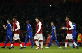 Arsenal's Nigerian striker Alex Iwobi (2L), Arsenal's Armenian midfielder Henrikh Mkhitaryan (C) and Arsenal's Gabonese striker Pierre-Emerick Aubameyang walk onto the pitch at the English Premier League football match between Arsenal and Everton at the Emirates Stadium in London on February 3, 2018. / AFP PHOTO / Adrian DENNIS / RESTRICTED TO EDITORIAL USE. No use with unauthorized audio, video, data, fixture lists, club/league logos or 'live' services. Online in-match use limited to 75 images, no video emulation. No use in betting, games or single club/league/player publications. /