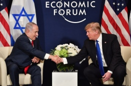 "Prime Minister Netanyahu is to meet his ""true friend"" Donald Trump in Washington on March 5, 2018 during a visit that will take him away from swirling accusations of personal corruption and a government crisis roiling the Israeli scene. On March 4, 2018 police questioned Netanyahu for five hours over a bribery scandal that some commentators say could spell his political doom. In two separate cases, the police last month recommended that he be charged with bribery, fraud and breach of public trust. / AFP PHOTO / Nicholas Kamm"