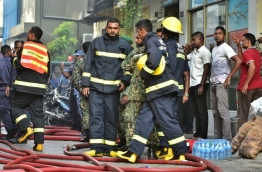 MNDF firefighters work to put out a fire that broke out in a house in capital Male on March 6, 2018. PHOTO: HUSSAIN WAHEED/MIHAARU