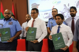 Acting CP Navaaz (L), Environment Minister Thoriq (M) and WAMCO MD Shifau posing for a picture after the agreement signing ceremony.