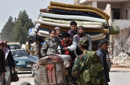 More than 200,000 civilians have fled the city of Afrin in northern Syria to escape a Turkish-led military offensive against a Kurdish militia, a war monitor said on March 17. Turkey and its Syrian Arab rebel allies have waged a nearly two-month offensive on the Afrin enclave, which is held by the Kurdish People's Protection Units (YPG). / AFP PHOTO / George OURFALIAN