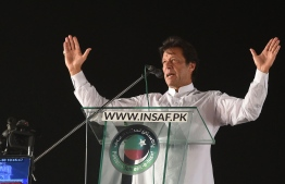 Pakistan opposition leader and leader of the Pakistani political party Pakistan Tehreek-e-Insaf (PTI - Pakistan Movement for Justice) Imran Khan delivers a speech during a political rally, in Lahore on April 29, 2018. Pakistan Tehreek-e-Insaf (PTI) displayed a strong show of power at Minar-e-Pakistan, as thousands of party supporters and workers from all over the country gathered at the ground.  / AFP PHOTO / ARIF ALI