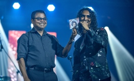 "Olympus, May 8, 2018: Environment Minister Thoriq Ibrahim (L) launches Ismail Affan's new album, ""Gen'bendhen"". PHOTO: NISHAN ALI/MIHAARU"