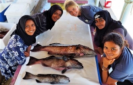 Shaa (Bottom Right) and Evans (Top Right) after a grouper dissection session with students.