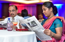 Hotel Jen, May 15, 2018: Invitees at the launch peruse Vol 1 of The Edition's print version. PHOTO: NISHAN ALI