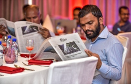 Hotel Jen, May 15, 2018: Invitees at the launch peruse Volume 1 of The Edition's print version. PHOTO: NISHAN ALI
