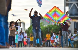 Male: People fly kites at the helipad site on the southern coast of the capital city; kite flying has long been a form of entertainment during the month of Ramadan in the Maldives. PHOTO: HUSSAIN WAHEED/MIHAARU