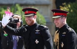 Britain's Prince Harry, Duke of Sussex, arrives with his best man Prince William, Duke of Cambridge, at the West Door of St George's Chapel, Windsor Castle, in Windsor, on May 19, 2018 for his wedding ceremony to marry US actress Meghan Markle. / AFP PHOTO / POOL / Jane Barlow