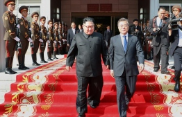 This handout taken on May 26, 2018 and released by South Korea's presidential Blue House on May 27, 2018 shows South Korea's President Moon Jae-in (R) and North Korea's leader Kim Jong Un (L) walking together after the summit at the north side of the truce village of Panmunjom in the Demilitarized Zone (DMZ) dividing the two Koreas. North and South Korea's leaders held surprise talks on May 26, to get a historic summit between Kim Jong Un and US President Donald Trump back on track after a head-spinning series of twists and turns. / AFP PHOTO / The Blue House AND AFP PHOTO / handout /