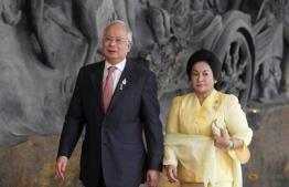 Former Malaysian Prime Minister Najib Razak and his wife Rosmah Mansor. PHOTO: REUTERS/STEPHEN MORRISON