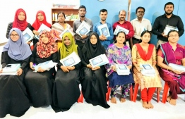 """Teachers of Vandhoo School with the new tablets: The education ministry brought over 70,000 """"Vave"""" tablets in their effort to digitise all the schools across Maldives. PHOTO: MINISTRY OF EDUCATION"""